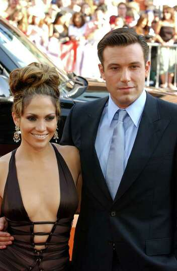 Ben Affleck and Jennifer Lopez pose for photographers as they arrive to the premiere of their film