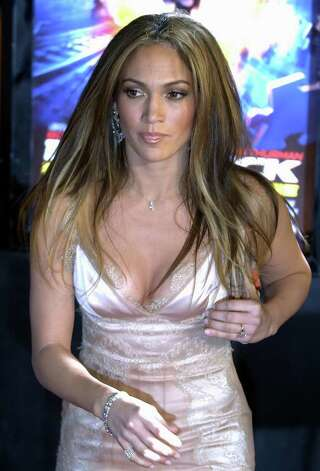 "Jennifer Lopez arrives at a screening of the film ""Paycheck,"" which stars Ben Affleck, at Grauman's Chinese Theater in Los Angeles, Thursday, Dec. 18, 2003. Photo: CHRIS PIZZELLO, AP / AP"