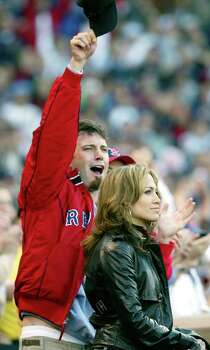 Boston Red Sox fans Ben Affleck, left, and Jennifer Lopez cheer during introductions prior to the start of  Game 3 of the American League Championship Series in New York Saturday, Oct. 11, 2003. The Sox will face the New York Yankees. Photo: WINSLOW TOWNSON, Ap / ap