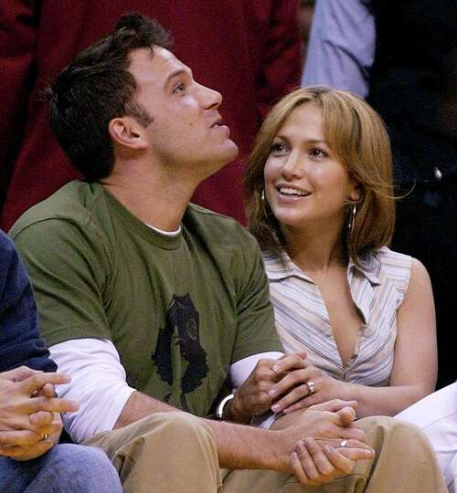 Actors Ben Affleck and Jennifer Lopez sit together at the Los Angeles Lakers' game against the San A