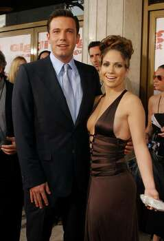 "Ben Affleck and Jennifer Lopez pose for photographers as they arrive to the premiere of their film ""Gigli,"" Sunday, July 27, 2003, in the Westwood section of Los Angeles. Photo: RENE MACURA, AP / AP"