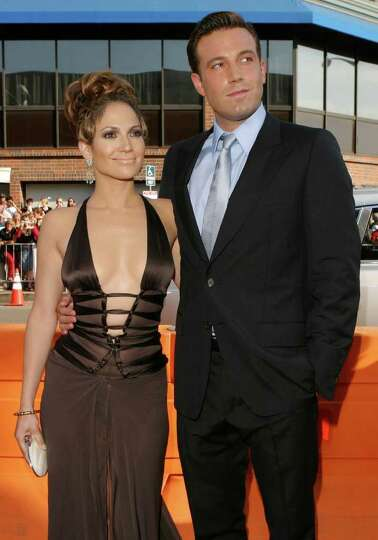 Jennifer Lopez and Ben Affleck walk the red carpet before the premiere of Gigli held at the Mann Nat