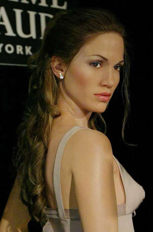 A wax figure of entertainer Jennifer Lopez is displayed  for the first time at Madame Tussaud's in New York, Wednesday, May 21, 2003. The company says that this is their first interactive figure. Photo: JOHN MARSHALL MANTEL, AP / AP