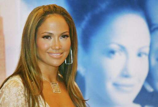 "U.S. movie star Jennifer Lopez poses during a photo call to promote her new film ""Maid in Manhattan"" in Berlin on Saturday, Feb.  22, 2003. Photo: JAN BAUER, AP / AP"