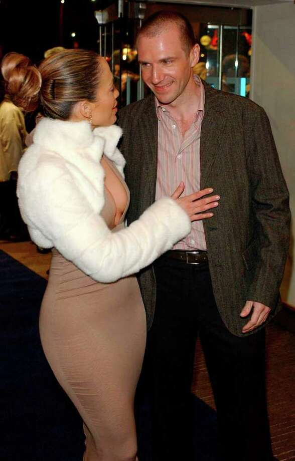 Jennifer Lopez, left, and Ralph Fiennes arrive for the United Kingdom gala celebrity premiere of 'Maid In Manhattan' at a cinema in Leicester Square, London Wednesday Feb. 26,  2003. The romantic comedy starring Jennifer Lopez and Ralph Fiennes tells the story of a struggling hotel housekeeper (Lopez) who falls for a rising politician (Fiennes), who mistakenly assumes she's a socialite guest at the hotel. (AP Photo/PA, Myung Jung Kim)  ** UNITED KINGDOM OUT   MAGAZINES OUT   NO SALES ** Photo: MYUNG JUNG KIM, AP / PA