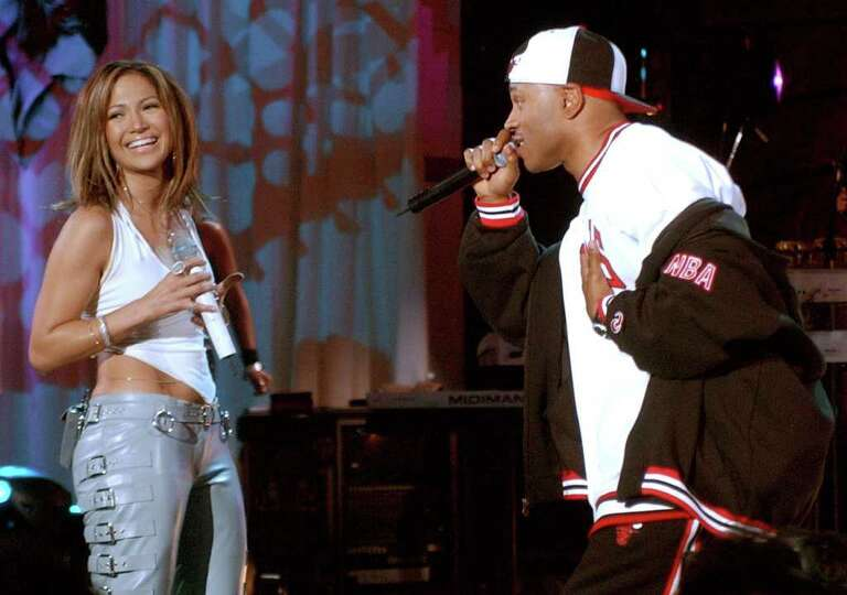 Jennifer Lopez smiles as she sings a duet with LL Cool J  at the Kips Bay Boys and Girls Club in the