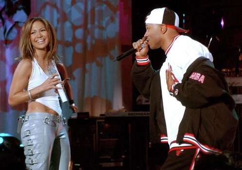 "Jennifer Lopez smiles as she sings a duet with LL Cool J  at the Kips Bay Boys and Girls Club in the Bronx borough of New York, during NBC's ""Today"" morning televison program appearance Friday Dec. 6, 2002. Photo: RICHARD DREW, AP / AP"