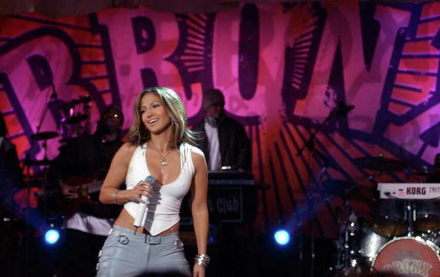 Jennifer Lopez performs at the Kips Bay Boys and Girls Club in the Bronx borough of New York, during