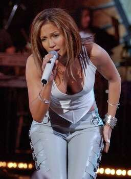 "Jennifer Lopez performs at the Kips Bay Boys and Girls Club in the Bronx borough of New York, during NBC's ""Today"" morning television program Friday Dec. 6, 2002. Photo: RICHARD DREW, AP / AP"