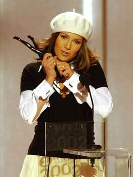 "Jennifer Lopez accepts the award for ""Most Influential Artist"" during the 2002 VH1/Vogue Fashion Awards at New York's Radio City Music Hall, Tuesday, Oct. 15, 2002. Photo: MARK LENNIHAN, AP / AP"