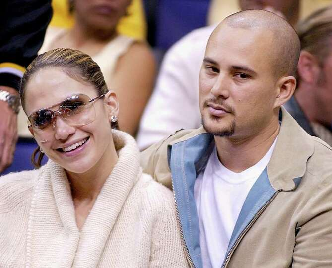 ** FILE **Jennifer Lopez and her husband, Cris Judd, are shown as they watch the Los Angeles Lakers