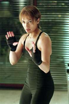 "Singer/actress Jennifer Lopez is shown in a scene from the Columbia Pictures thriller, ""Enough,"" in this undated promotional photo. Sony Pictures for the 2002 summer is expected to surpass the 1997 summer schedule when the studio had a record box-office haul of $1.26 billion domestically for the entire year.  The 2002 summer lineup is anchored by the action-adventure ""Spider-Man,"" and sequels to ""Men in Black"" and ""Stuart Little,"" as well as the Jennifer Lopez thriller ""Enough,"" and the extreme-sports spy caper ""XXX,"" starring Vin Diesel. Photo: VAN REDIN, AP / COLUMBIA PICTURES"