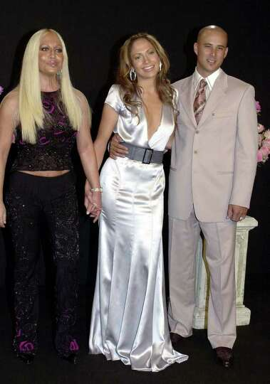 Italian fashion designer Donatella Versace, left, with actress and singer Jennifer Lopez and her hus