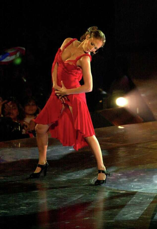 Jennifer Lopez performs in San Juan, Puerto Rico on Saturday, Sept. 22, 2001. Photo: TOMAS VAN HOUTRYVE, AP / AP