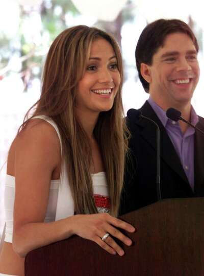 Jennifer Lopez, left, and Andy Hilfiger, the brother of designer Tommy Hilfiger at a press conferenc