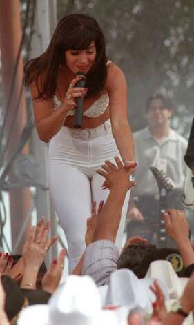 Jennifer Lopez performs as Selena during the filming of the Selena movie Saturday in Poteet.  E/N Photo by Doug Sehres. Photo: DOUG SEHRES, SAN ANTONIO EXPRESS-NEWS