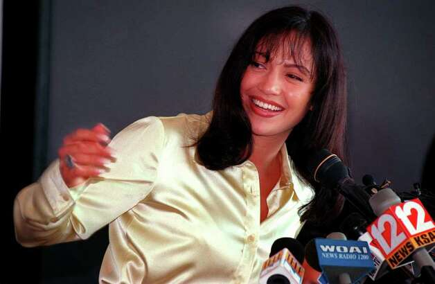Actress Jennifer Lopez, who was chosen to play Selena in the upcoming movie, answers questions from the media Tuesday afternoon at the Aladome during a press conference to announce initial shooting which will start Wednesday.  Rick Hunter/Staff Photo: RICK HUNTER