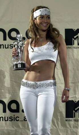 "Jennifer Lopez poses with her Best Dance Video award for her song ""Waiting For Tonight"" at the 2000 MTV Music Video Awards Thurdsay, Sept. 7, 2000, at Radio City Music Hall in New York. Photo: DAN LOH, AP / AP"