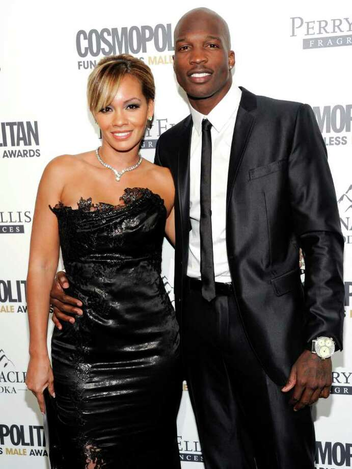 NFL Football player and reality television star Chad Ochocinco and his fiancee Evelyn Lozada attend Cosmopolitan Magazine's 'Fun Fearless Males of 2011' event on   Monday, March 7, 2011 in New York. Photo: AP