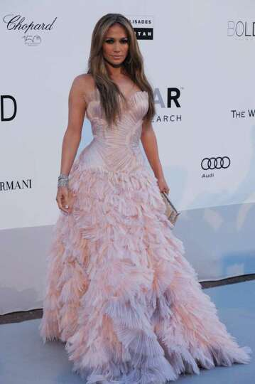 US actress and singer Jennifer Lopez poses while arriving to attend the 2010 amfAR's Cinema Against