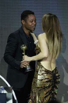 MONTE CARLO, MONACO - MAY 18:  Y 18: (UK TABLOID NEWSPAPERS OUT) Jennifer Lopez accepts her Legend Award for Outstanding Contribution to the Arts award from Cuba Gooding Jr at the World Music Awards 2010 held at the Sporting Club Monte-Carlo on May 18, 2010 in Monte-Carlo, Monaco.  (Photo by Dave Hogan/Getty Images) *** Local Caption *** Jennifer Lopez;Cuba Gooding Jr Photo: Dave Hogan, Getty Images / 2010 Dave Hogan