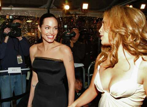 "WESTWOOD, CA - DECEMBER 08:  Actress Angelina Jolie and actress/singer Jennifer Lopez arrive at the premiere of Paramount's ""The Curious Case Of Benjamin Button"" held at Mann's Village Theatre on Decemeber 8, 2008 in Westwood, California.  (Photo by Alberto E. Rodriguez/Getty Images) *** Local Caption *** Angelina Jolie;Jennifer Lopez Photo: Alberto E. Rodriguez, Getty Images / 2008 Getty Images"