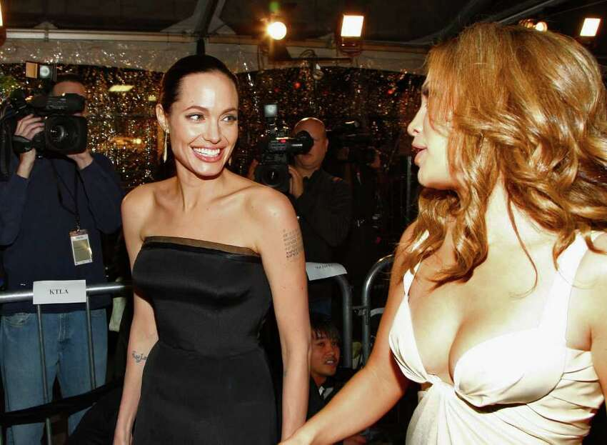 WESTWOOD, CA - DECEMBER 08: Actress Angelina Jolie and actress/singer Jennifer Lopez arrive at the premiere of Paramount's