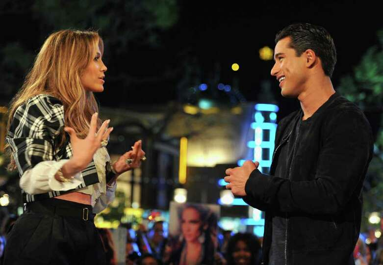 LOS ANGELES, CA - MARCH 03:  Singer/actress Jennifer Lopez and TV host Mario Lopez at a taping of