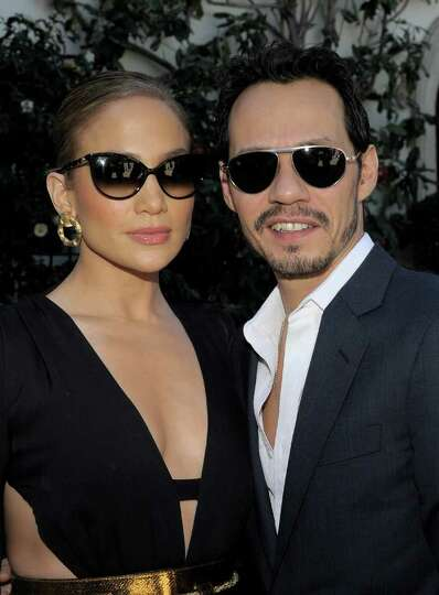 LOS ANGELES, CA - FEBRUARY 11:  Singers Jennifer Lopez (L) and Marc Anthony attend the first annual