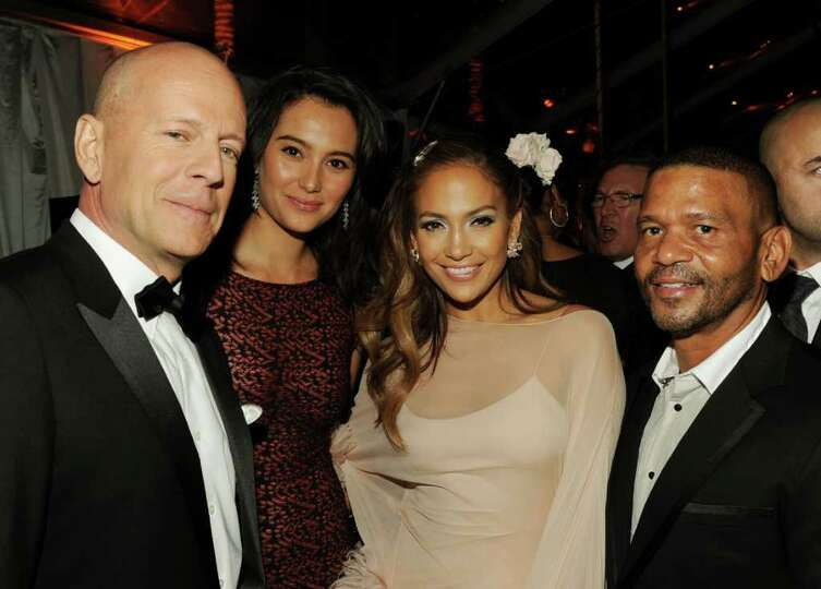 BEVERLY HILLS, CA - JANUARY 16:  (L-R) Actor Bruce Willis, Emma Heming, singer/actress Jennifer Lope