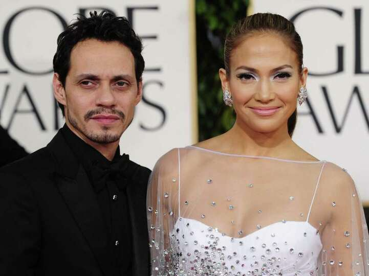 Singer Marc Anthony (L) and singer/actress Jennifer Lopez (R) arrive for the 68th annual Golden Glob