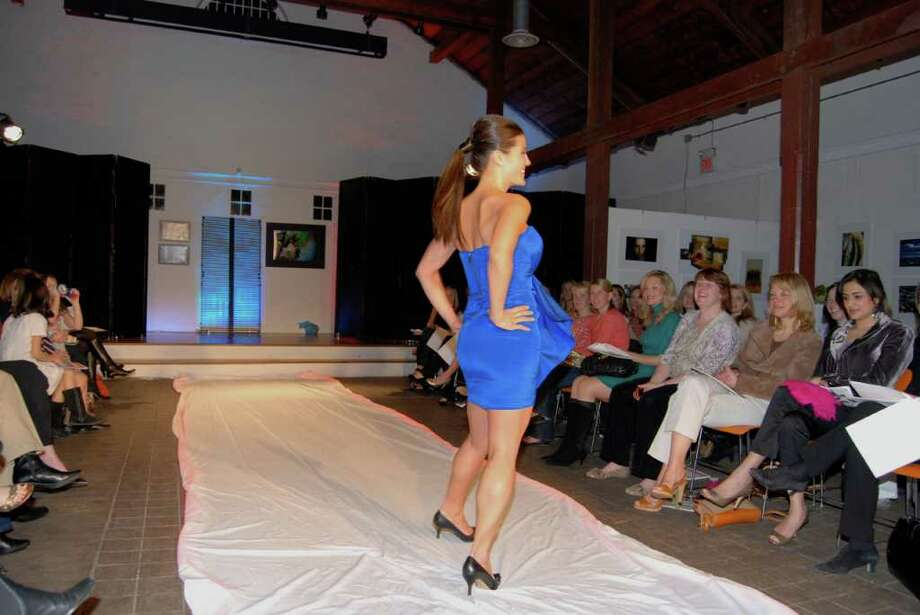 Pamela Shimono dazzles the couture crowd wearing a Nicole Miller strapless dress from Lyn Evans for Potpourri Designs at the New Canaan Young Women's League Annual Fashion Show on April 7, 2011 at the Waveny Carriage Barn. Photo: Jeanna Petersen Shepard / New Canaan News