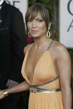 BEVERLY HILLS, UNITED STATES:  (FILES) US actress/singer Jennifer Lopez arrives for the Golden Globe Awards ceremony 25 January 2004, at the Beverly Hilton Hotel in Beverly Hills, California. Lopez has married for a third time, tying the knot with Latin crooner Marc Anthony in a surprise ceremony, People magazine reported 06 June, 2004. The magazine wrote that Lopez, who broke off her highly-publicized engagement with Hollywood heartthrob Ben Affleck just a few months ago, wed Marc Anthony late 05 June, in a casual ceremony at her Beverly Hills home.   AFP PHOTO / ROBYN BECK Photo: ROBYN BECK, AFP/Getty Images / 2004 AFP