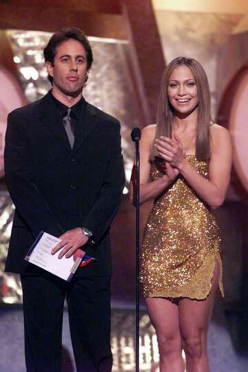 Comedian Jerry Seinfeld and actress Jennifer Lopez present an award at the 41st Annual Grammy Awards