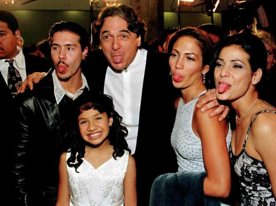 "HOLLYWOOD, :  Cast members from left: Jon Seda, Becky Lee Meza, director-writer Gregory Nava, Jennifer Lopez and Constance Marie make funny faces for photographers at the world premiere of the film ""Selena"" 13 March in Hollywood. Meza and Lopez star in the title role which documents the life of Latina singer Selena, who was  mudered by her manager in 1995. AFP PHOTO  Vince BUCCI Photo: Vince Bucci, AFP/Getty Images / AFP"