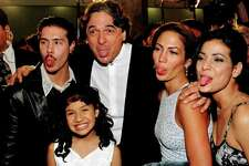 "HOLLYWOOD, :  Cast members from left: Jon Seda, Becky Lee Meza, director-writer Gregory Nava, Jennifer Lopez and Constance Marie make funny faces for photographers at the world premiere of the film ""Selena"" 13 March in Hollywood. Meza and Lopez star in the title role which documents the life of Latina singer Selena, who was  mudered by her manager in 1995. AFP PHOTO  Vince BUCCI"