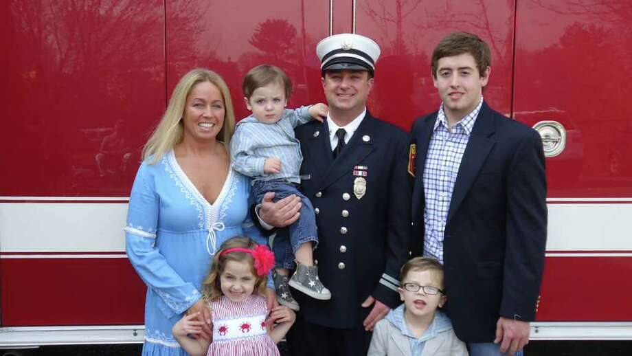 Jon Maggio, his wife Michelle, and their four children pose for a photo as his promotion ceremony Monday. Maggio, who joined the Norwalk Fire Department in 1994, was promoted to captain. Photo: Contributed Photo / Norwalk Citizen