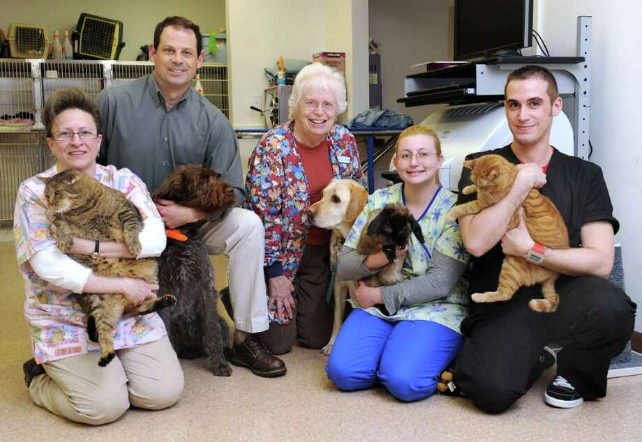 The staff of Fieldstone Veterinary Care in New Fairfield includes, from left, office manager Joanna Tata, Dr. Mark Brummitt, Dr. Priscilla Lightcap, veterinary technician Jessy Elkins, receptionist Phil Ferry. Photo taken Tuesday, April 12, 2011. Photo: Carol Kaliff / The News-Times