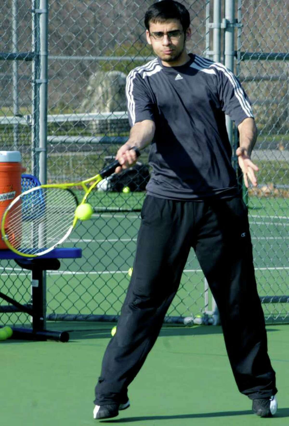 SPECTRUM/Tyler Palmese rips a forehand during practice for Shepaug Valley High School boys' tennis. April 2011