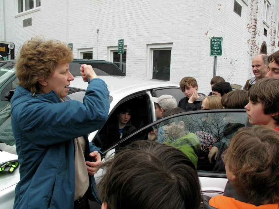 Sgt. Ogrinc explains seat belt safety to the boy scouts from Troop 2. Photo: Contributed Photo / New Canaan News