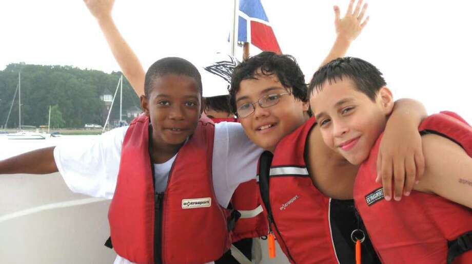 Among the Young Mariners of Greenwich who recently earned their Connecticut safe boating certificates are, from left, Jaden Williams, Gianfranco Bellamusto and Jesus Salcedo. Photo: Contributed Photo / Greenwich Citizen