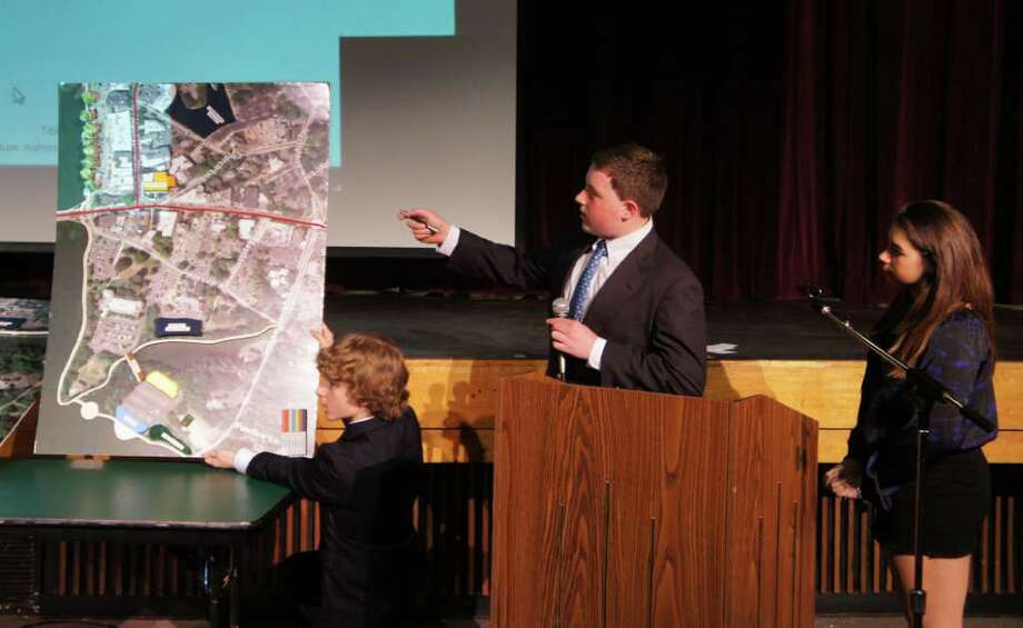 From left, Coleytown Middle School eighth-graders Andrew Ippolito, Conor Keenan and Izzy Calderon present their group's downtown revitalization plan on Tuesday, April 12, 2011 at Coleytown Middle School. Photo: Paul Schott / Westport News