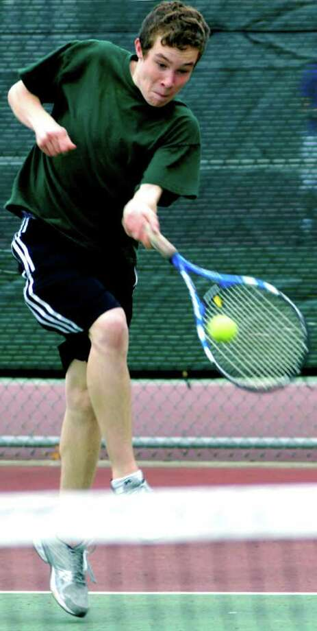 SPECTRUM/Freshman singles hopeful Nick Eherts of New Milford High School boys' tennis fights off a teammate's volley during pre-season practice at NMHS. April 2011 Photo: Norm Cummings / The News-Times
