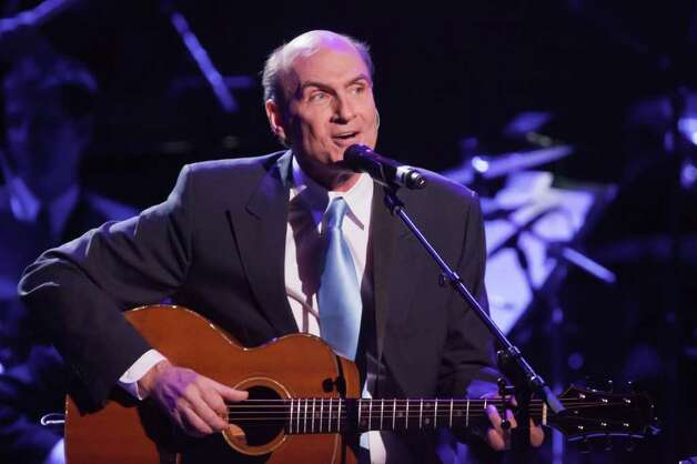 In this publicity image released by Carnegie Hall, James Taylor performs during a gala marking Carnegie Hall's 120th anniversary, Tuesday, April 12, 2011 in New York. (AP Photo/Carnegie Hall, Chris Lee) Photo: Chris Lee
