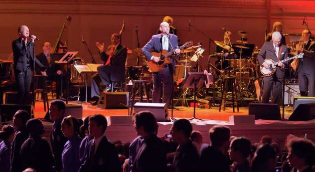 In this publicity image released by Carnegie Hall, Sting, left, James Taylor, center, and Steve Martin perform during a gala marking Carnegie Hall's 120th anniversary, Tuesday, April 12, 2011 in New York. (AP Photo/Carnegie Hall, Chris Lee) Photo: Chris Lee