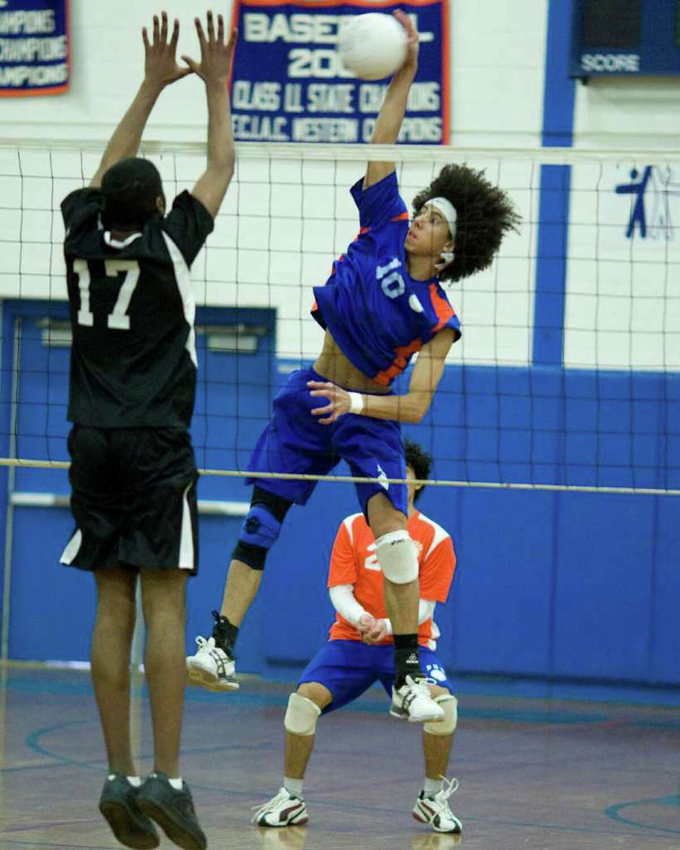Danbury's Matheus Ananias blasts a return against Bridgeport Central Wednesday at Danbury High School.
