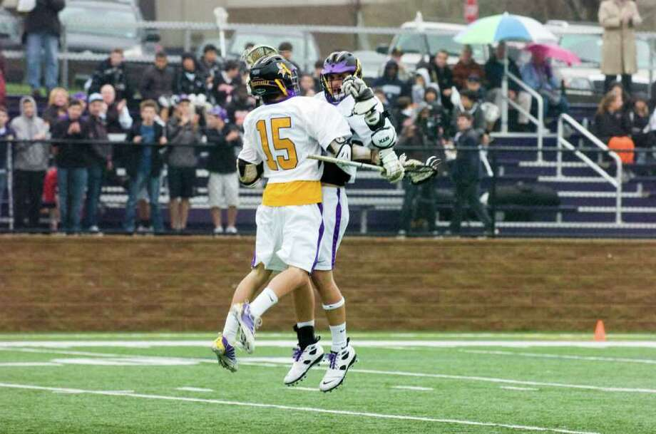 Westhill's Matt Biancuzzo, left, celebrates with Austin Wentworth after Wentworth scored as city rivals Stamford and Westhill boys lacrosse teams face off at Westhill High School  in Stamford, Conn., April 13, 2011. Photo: Keelin Daly / Stamford Advocate