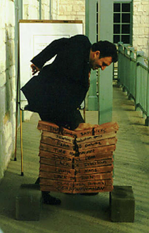 Winslow Swart breaks bricks as part of a training session for Citibank executives at the Hyatt Hill Country resort in the mid-1990s. Photo: COURTESY OF WINSLOW CONSULTING