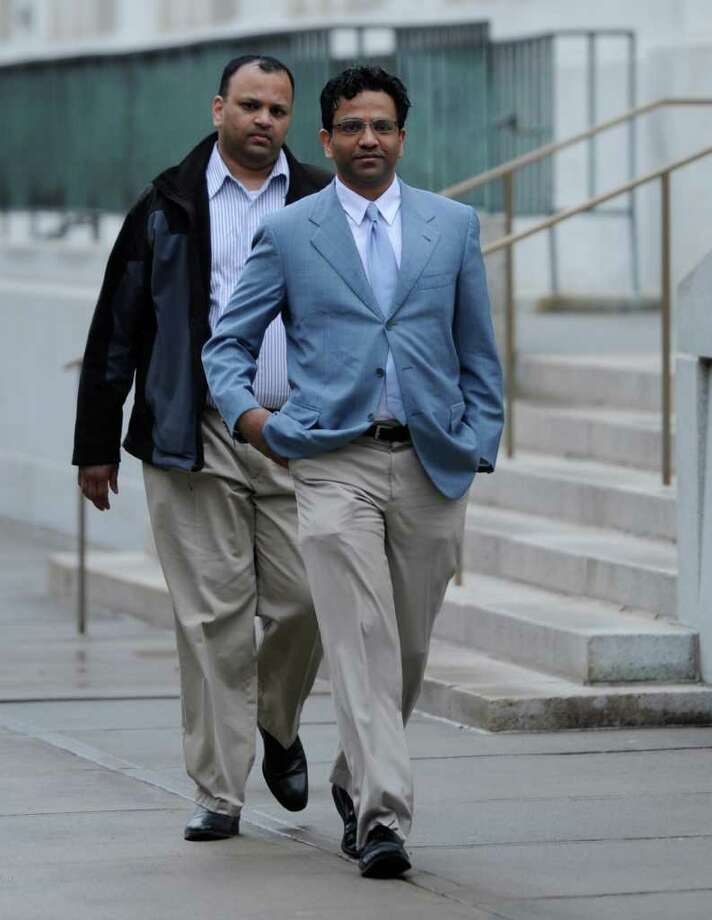 Giridhar Sekhar arrives for his trial in Federal Court in Albany, N.Y. April 13, 2011, on charges that he allegedly blackmailed Comptroller Tom DiNapoli's top attorney to secure business with the pension fund. (Skip Dickstein / Times Union) Photo: SKIP DICKSTEIN / 00012758A