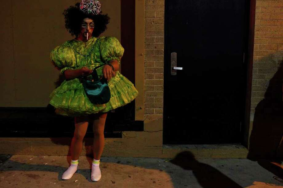 "Kit Gonzales takes a smoke break while waiting to perform ""Vice-Empress of Tiger Moms, Toddlers and Tiaras"" during Cornyation at the Charline McCombs Empire Theatre on Tuesday, April 12, 2011. Photo: LISA KRANTZ, Lisa Krantz/Express-News / SAN ANTONIO EXPRESS-NEWS"